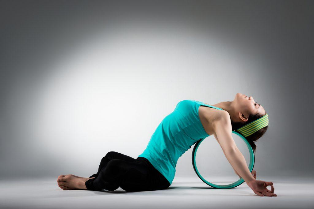 yoga massage with yoga wheel